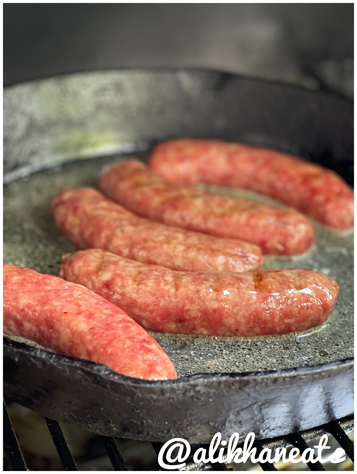 Brats simmering in butter and beer